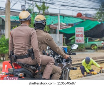 Editorial use only; thai police patrol on a motorcycle, taken at Pathumthani, Thailand, on July 16th, 2018.