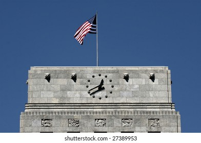 Editorial Use Only: Top of Houston City Hall with American Flag and Clock (Release Information: Editorial Use Only. Use of this image in advertising or for promotional purposes is prohibited.)