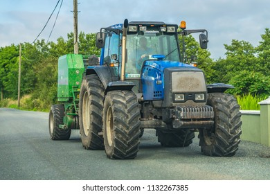 Editorial use only; tractor with large wheels and tires on a rural road, taken at Legga, Co. Longford, Ireland, in July 2018.