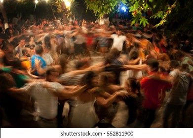 """Editorial use only"" Traditional festival  with people who dancing on a traditional festival in Ikaria  island ,with motion blur effect. Ikaria, Greece, August 16 -  2016.""Editorial use only"""
