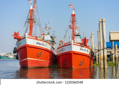 Editorial use only; two large fishing trawlers at Maha Chai, Samut Sahkon, Thailand, taken in April 2018.