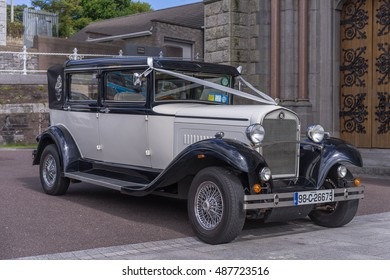 Editorial use only; Vintage style wedding car at St. Coleman's Cathedral on Sept 2nd, 2016.
