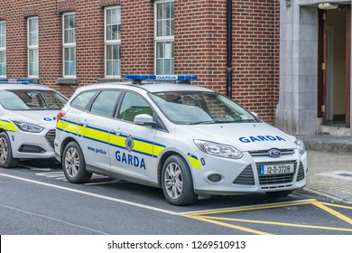 Editorial use only; white police cars parked outside an Irish police station, at Athlone, Co. Westmeath, Ireland in July 2017.