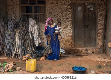 Editorial use only. Women work hard from early ages in Africa, taking care of the household and having 4 to 7 children. Image taken in the remote village of Uzi, Zanzibar Island, Tanzania, April 2016.