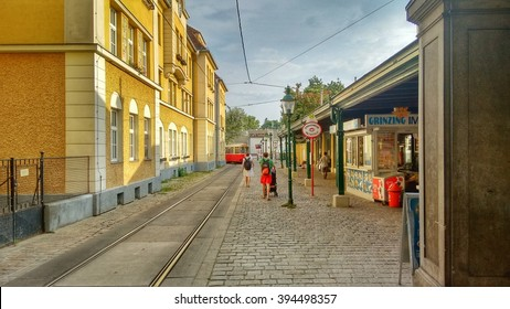 Editorial: Vienna, Austria, 16th August 2015. Tram and bus stop in Vienna's old historical quarter called 'Grinzing'. Old tram just leaving the station.