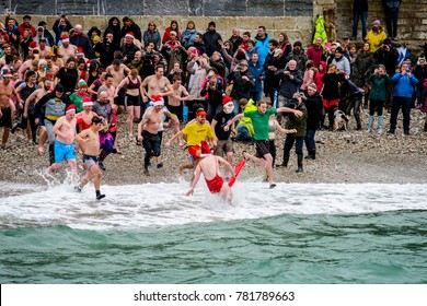 Editorial:Charlestown Harbour, St Austell, Cornwall, UK, 12/26/2017  Members of the public swimming in the sea on Boxing Day for charity.
