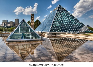 EDMONTON, AB, CANADA - JULY 8: The Muttart Conservatory stands against the Edmonton skyline July 8, 2014. The buildings' glass pyramids are one of Edmonton's most famous icons built in 1976.