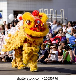 EDMONTON, AB, CANADA-July 18, 2014:  People performing in Chinese dragon costumes as seen in the K-Days Parade on July 18th, 2014.