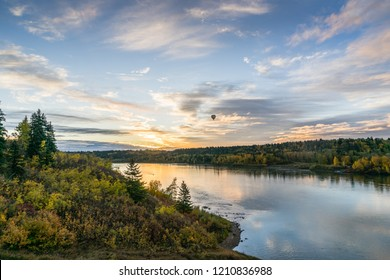 Edmonton, Alberta autumn landscape with sunrise and hot air balloon and sky reflection in  North Saskatchewan river