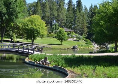 Edmonton, Alberta, Canada, July 17, 2019: The Kurimoto Japanese Garden at the University of Alberta Botanic Garden in Edmonton.  These gardens feature a pond, bridge, water falls and other features.