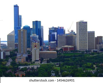 Edmonton, Alberta, Canada - July 2019: Edmonton downtown Summer skyline just before sunset at the day hour showing River Valley parks and surrounding skyscrapers.