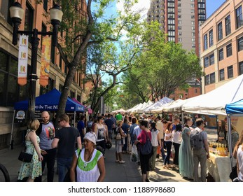 Edmonton, Alberta, Canada - June 24th, 2017: The local farmers market in downtown Edmonton, Alberta, Canada is busy with locals and tourists looking to buy fresh local food and designed clothes.