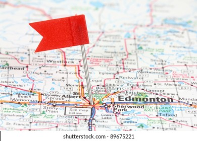 Edmonton in Alberta, Canada. Red flag pin on an old map showing travel destination.