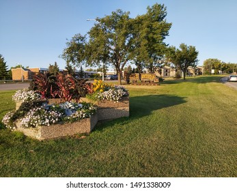 Edmonton, Alberta/Canada - Aug 28 2019. The Welcome to Old Towne Beverly sign, preceded by a raised bed of flowers, on 118th Ave/Victoria Trail.