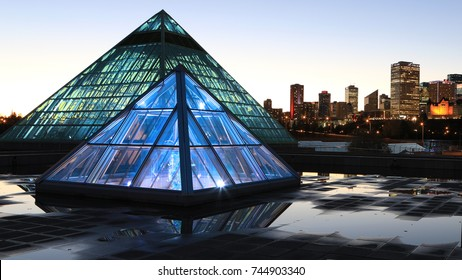 EDMONTON, ALBERTA/CANADA- OCTOBER 17, 2017: Muttart Conservatory in Edmonton, Canada at night [Edmonton] The pyramids house different plant biomes