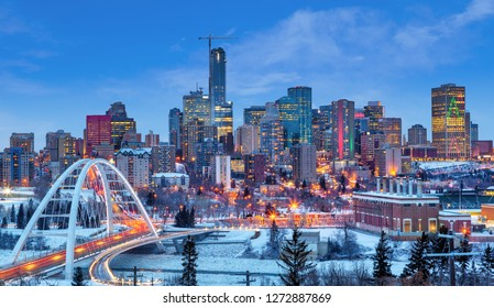 Edmonton downtown Winter skyline just after sunset showing Walterdale Bridge across the frozen, snow-covered Saskatchewan River and surrounding skyscrapers. Edmonton is the capital of Alberta, Canada.