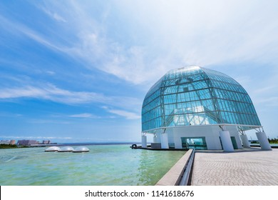 """EDOGAWA, TOKYO / JAPAN - JULY 21 2018 : Scenery of """"TOKYO SEA LIFE PARK"""" (Kasai Rinkai Suizokuen). At the entrance of the aquarium there is a glass dome and a pond."""