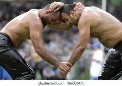 EDRNE, TURKEY, 23 JUNE 2015, Two oil wrestler wrestling in Kirkpinar, Edirne