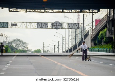 EDSA, Philippines - February 2016: Worker cleaning an empty road