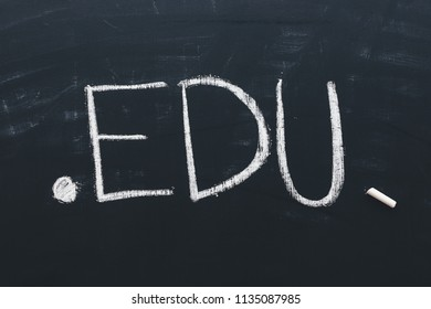 Edu internet domain for educational institutions, conceptual image of text written in chalk on school blackboard