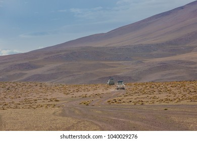 Eduardo Avaroa National Park, Bolivia,  offroad vehicle driving in the wilderness of Andean mountains