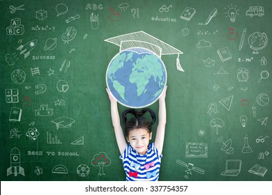 Educated school child girl lifting world globe doodle on chalkboard for children's education international children day and  world literacy day concept