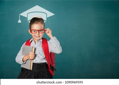 Educated school kid student with graduation