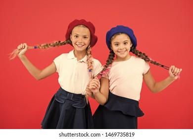 Education abroad. Apply form enter international school. French language school. School fashion concept. Pupil smiling girls wear formal uniform and beret hats. International exchange school program.