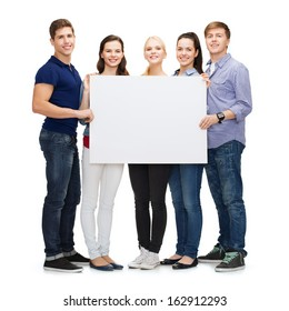 education, advertisement, sale and people concept - group of smiling students with blank white board