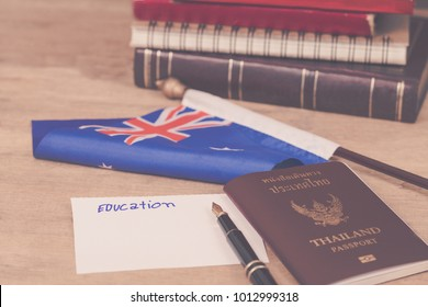 Education in Australia concept, with a passport and white note on Australian flag.