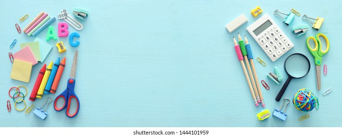 education and back to school concept. stationery over wooden blue background. top view, flat lay