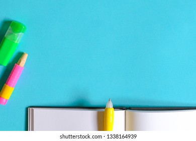 Education or back to school concept : top view or flat lay of chalks, pencil, magic colors, eraser, oil pastels, scissors, notebook with copy space