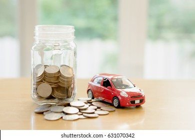 Education budget concept. Car money savings in a glass