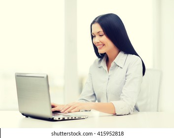 education, business and technology concept - smiling businesswoman or student with laptop computer