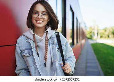 Education, career and people concept. Close-up portrait of successful pretty young woman studying IT, head to co-working space to do some freelance, smiling happy camera, stand outdoors