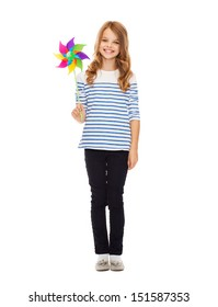education, childhood and ecology concept - child with colorful windmill toy