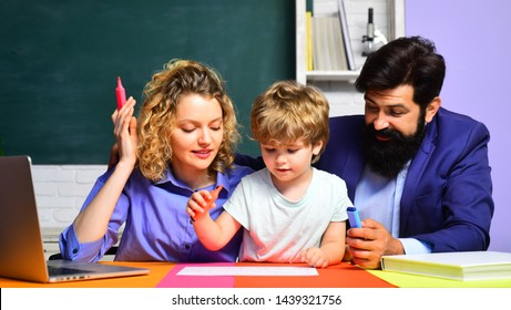 Education for children out of school. Parents feeling proud on progress of son. Family day. Family school partnership. School kids. Young couple helping his son to make homework. Beginning of lessons.