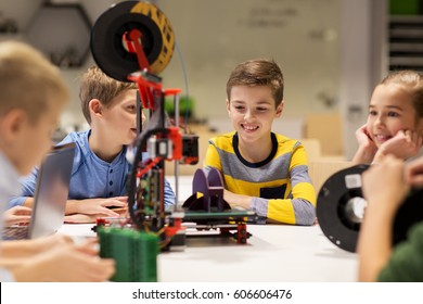 education, children, technology, science and people concept - group of happy kids with 3d printer at robotics school lesson