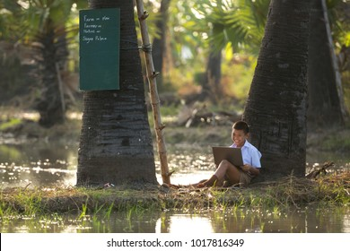 Education concept. Asia boy are student using computer laptop for learning by internet network. Learning through modern teaching media with technology has made rural growth .21st century thailand 4.0