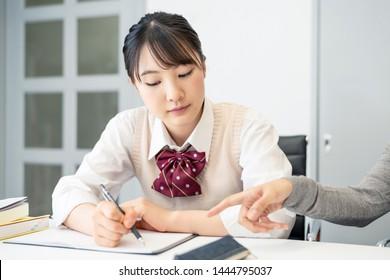 Education concept of an asian high school girl. Cram school. Private teacher.