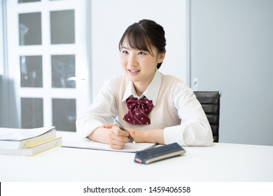 Education concept of an asian high school girl. Cram school. Private lesson.