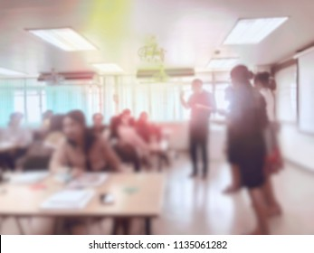 Education concept, blurred students studying in large hall with screen and projector for showing information people teacher room presentation