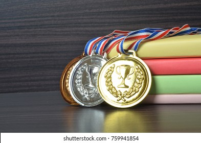 Education concept: books, set of medals