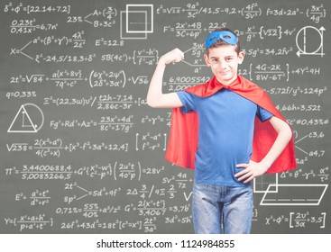 Education concept with confident super hero boy in front of a blackboard
