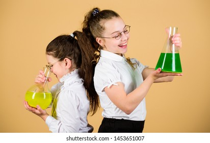 Education concept. Fascinating experiment. Basic knowledge. Knowledge day. Schoolgirls friends with chemical liquids. Childhood and upbringing. Knowledge and information. Experimenting together.