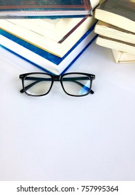 Education concept -new and old books with glasses on white background .research information reference paper at library school