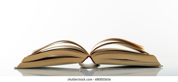 Education concept. Old book open on white background