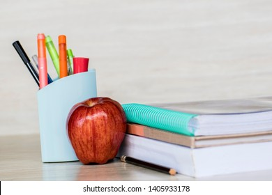 Education concept, Red aple write book colorful pens and global with wooden backgrounds.learning in 21st century. Knowledge management. Innovation active for student.selective focus image.