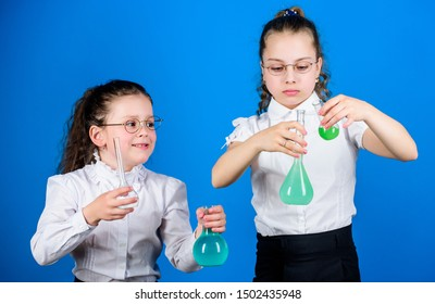 Education concept. Safety measures. Small kid study. Chemistry lesson. Having fun with chemistry. Educative experiment. Chemistry fun. Knowledge day. Schoolgirl with colorful chemical liquids.