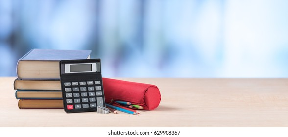 Education concept with school supplies on blurred background
